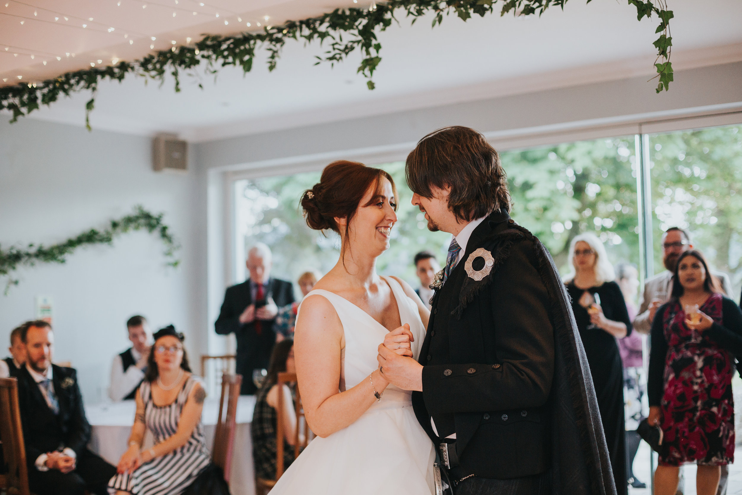 Bride and Groom has first dance in front of their wedding guests at Altskeith Country House, Loch Ard, Scotland.