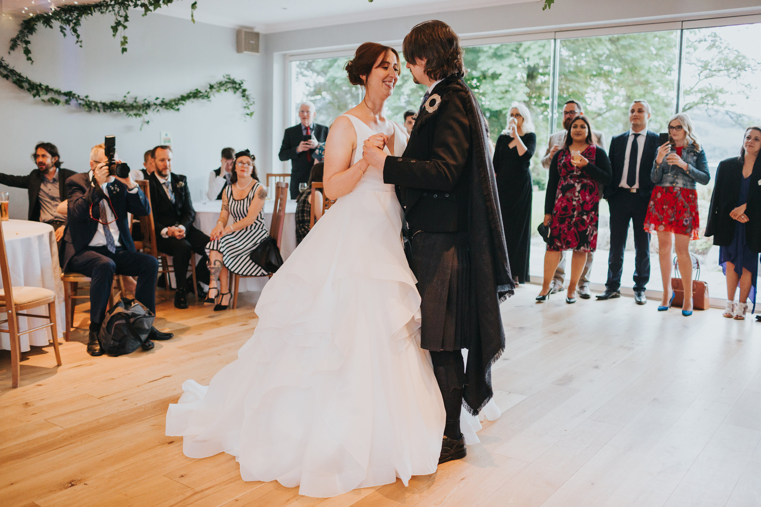 Bride and groom have their first dance.