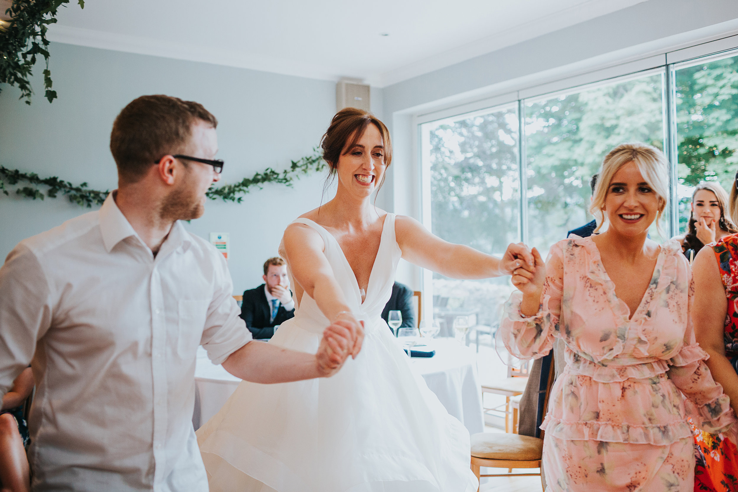 Bride dancing with her guests.