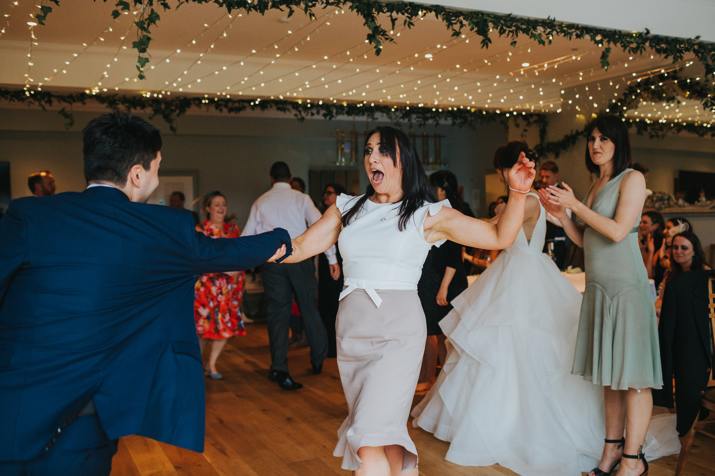 Wedding guest shrieks and nearly slips.