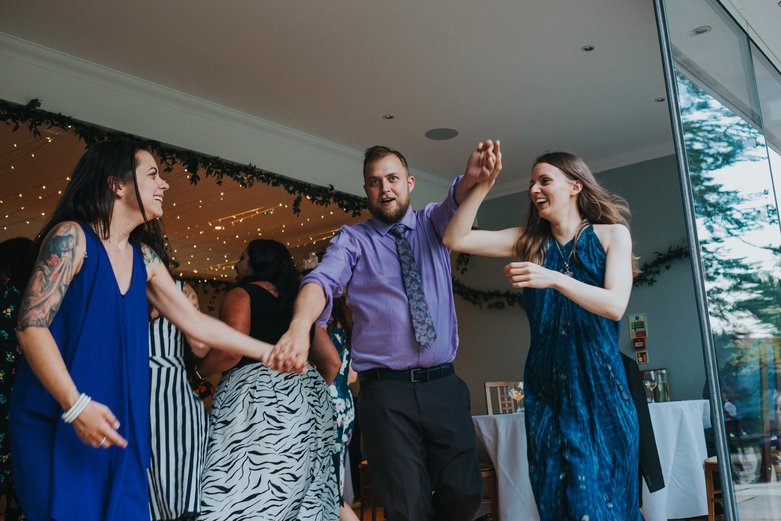 Wedding guests make some shapes.
