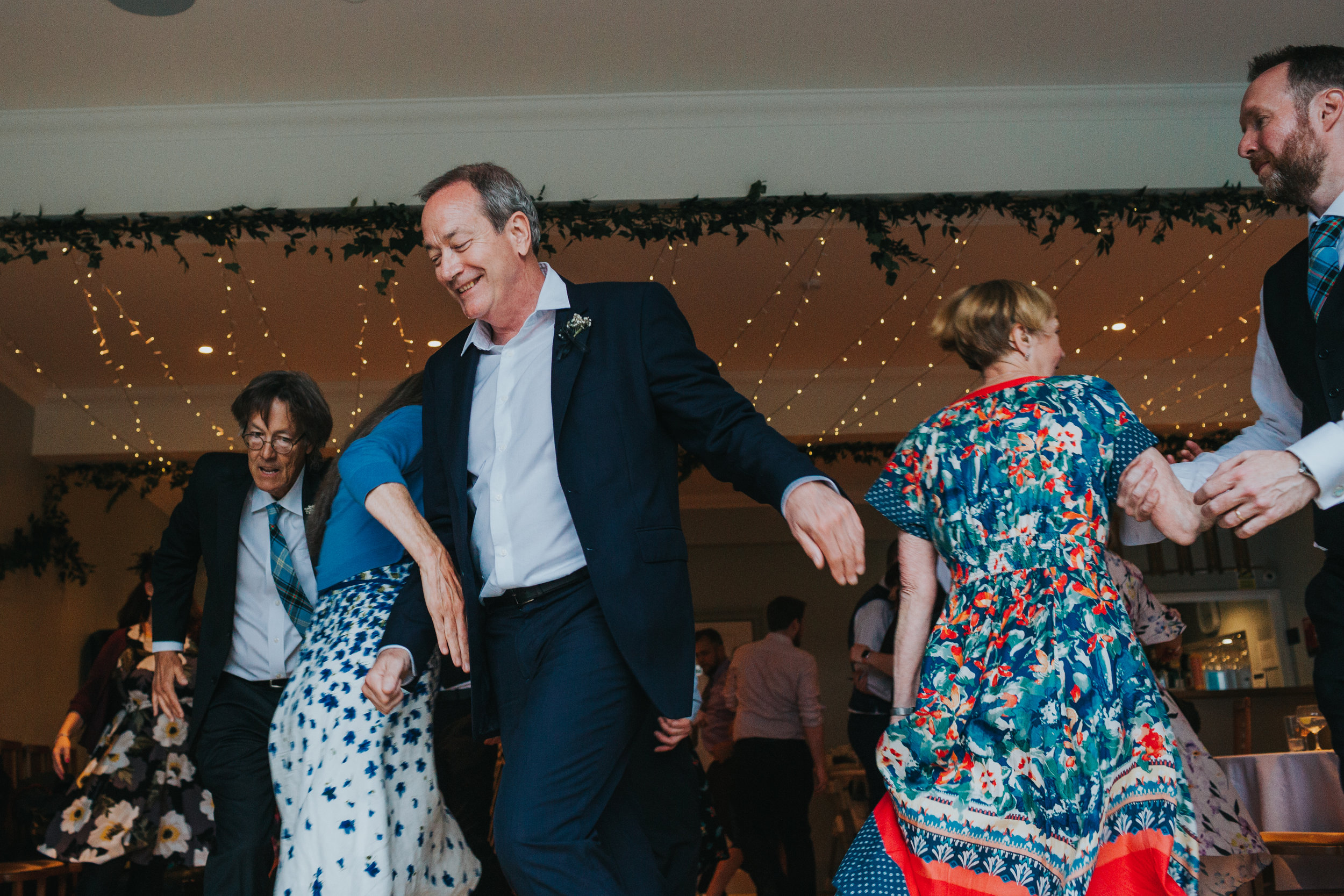 Guests run around the dance floor.