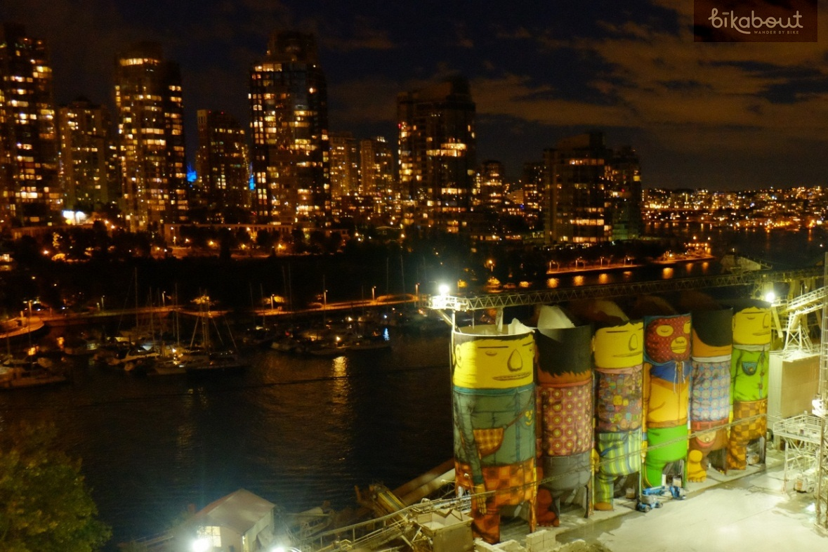 """OSGEMEOS """"Giants"""" mural is spectacular against city skyline at night"""