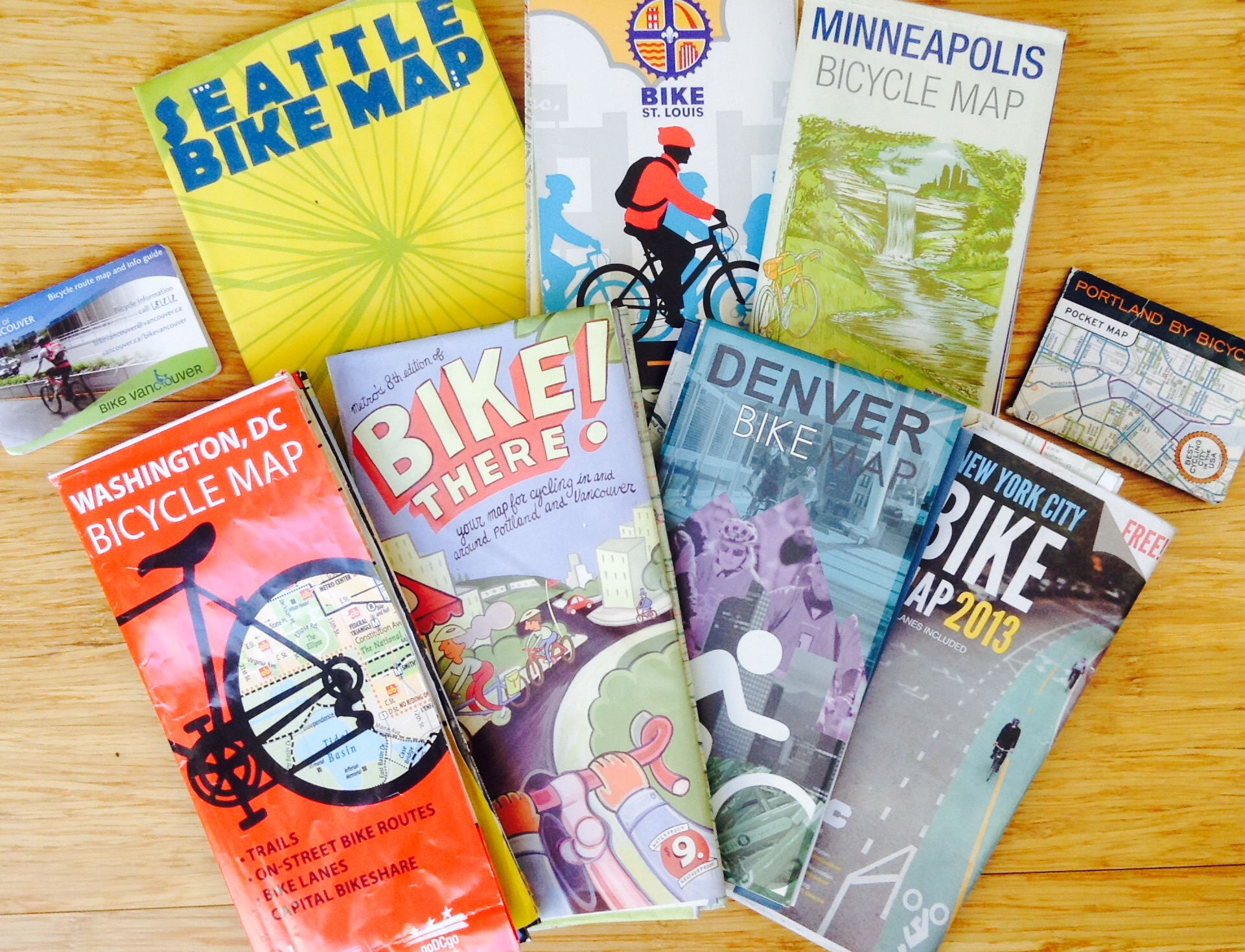 Your city's bike department will mail you oodles of the local bike map for free, simply by requesting them.