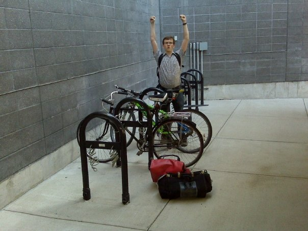 Bike racks at terminal A, the first time we used them in 2009. I was excited to find our bikes right where we left them a week earlier. Note the dangling curly steel security cables. Loop them through your wheels and lock them up, too.