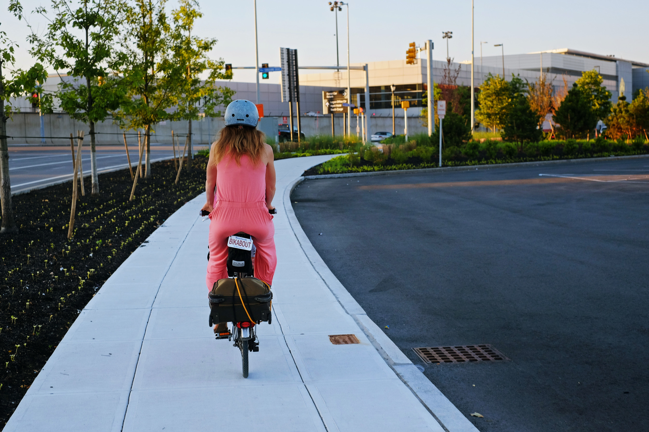 The Harborside Road sidewalks from the Greenway to terminal A: Wide, pristine, and devoid of foot-bound traffic. Giddyup!