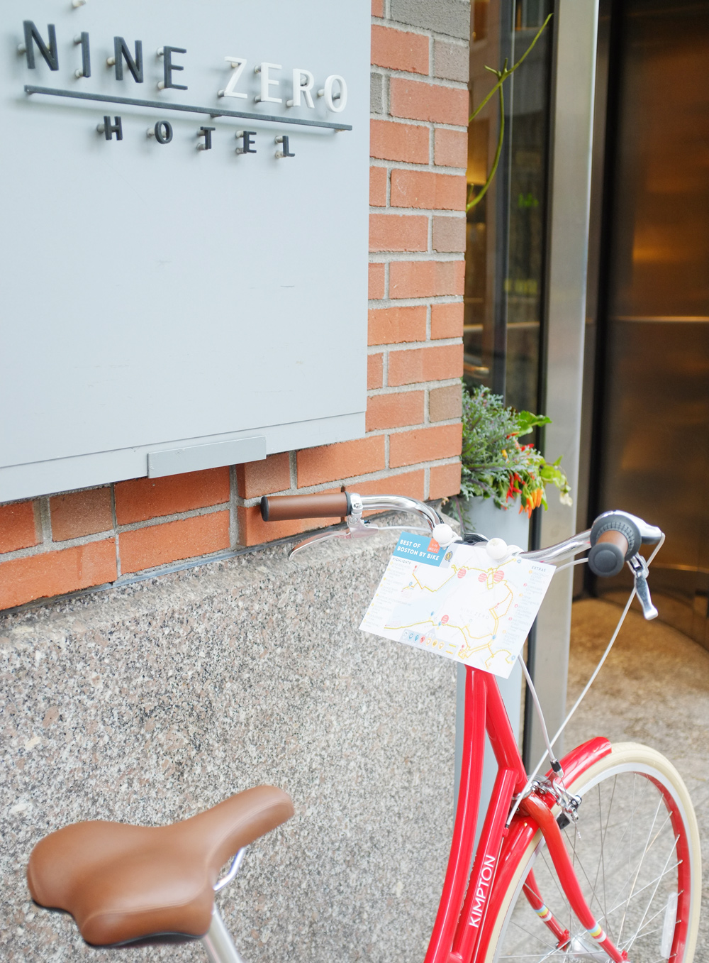 "Nine Zero Hotel's bikes with ""Best of Boston by Bike"" map mounted to the handlebars to make navigating easy."