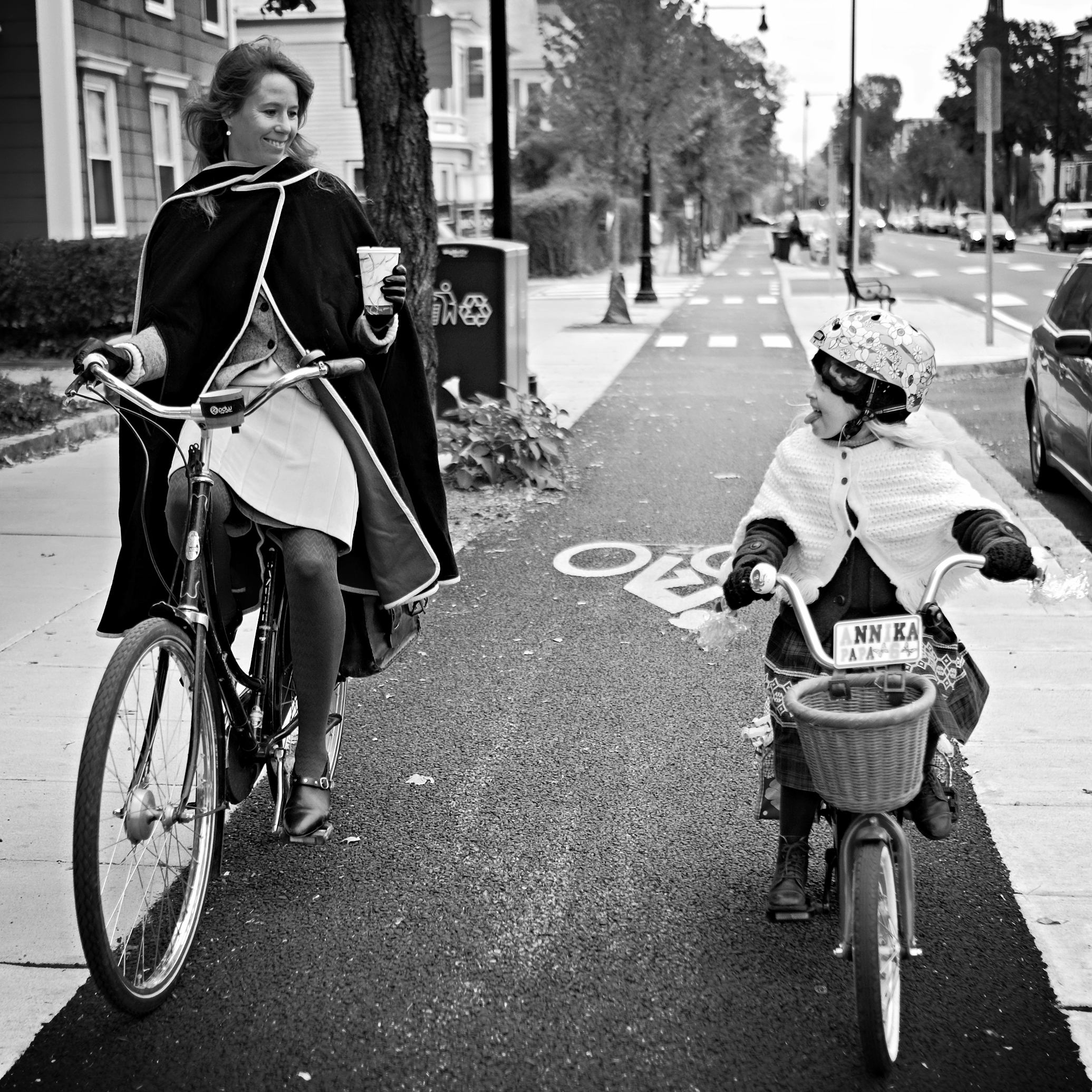Bikabout-Boston-mother-daughter-biking-on-Western-Ave-cycle-track.JPG