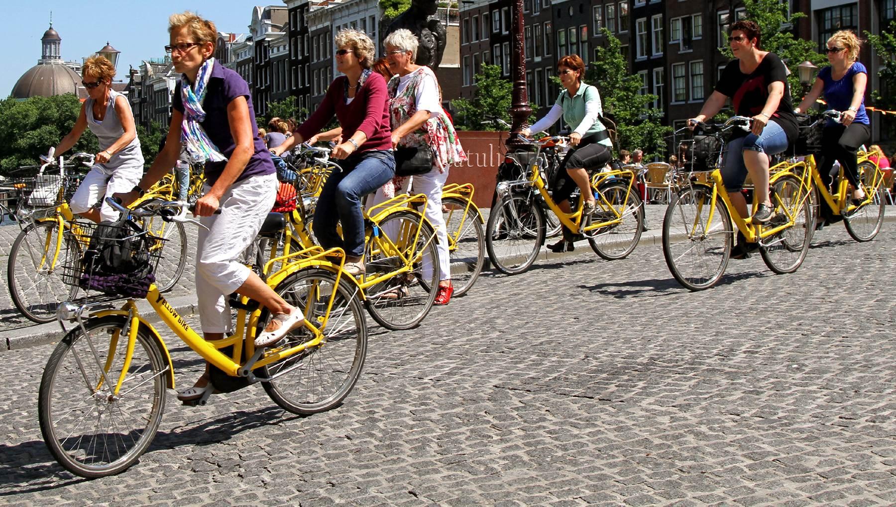 Bike tour in Amsterdam.Photo credit to IAmAmsterdam.com