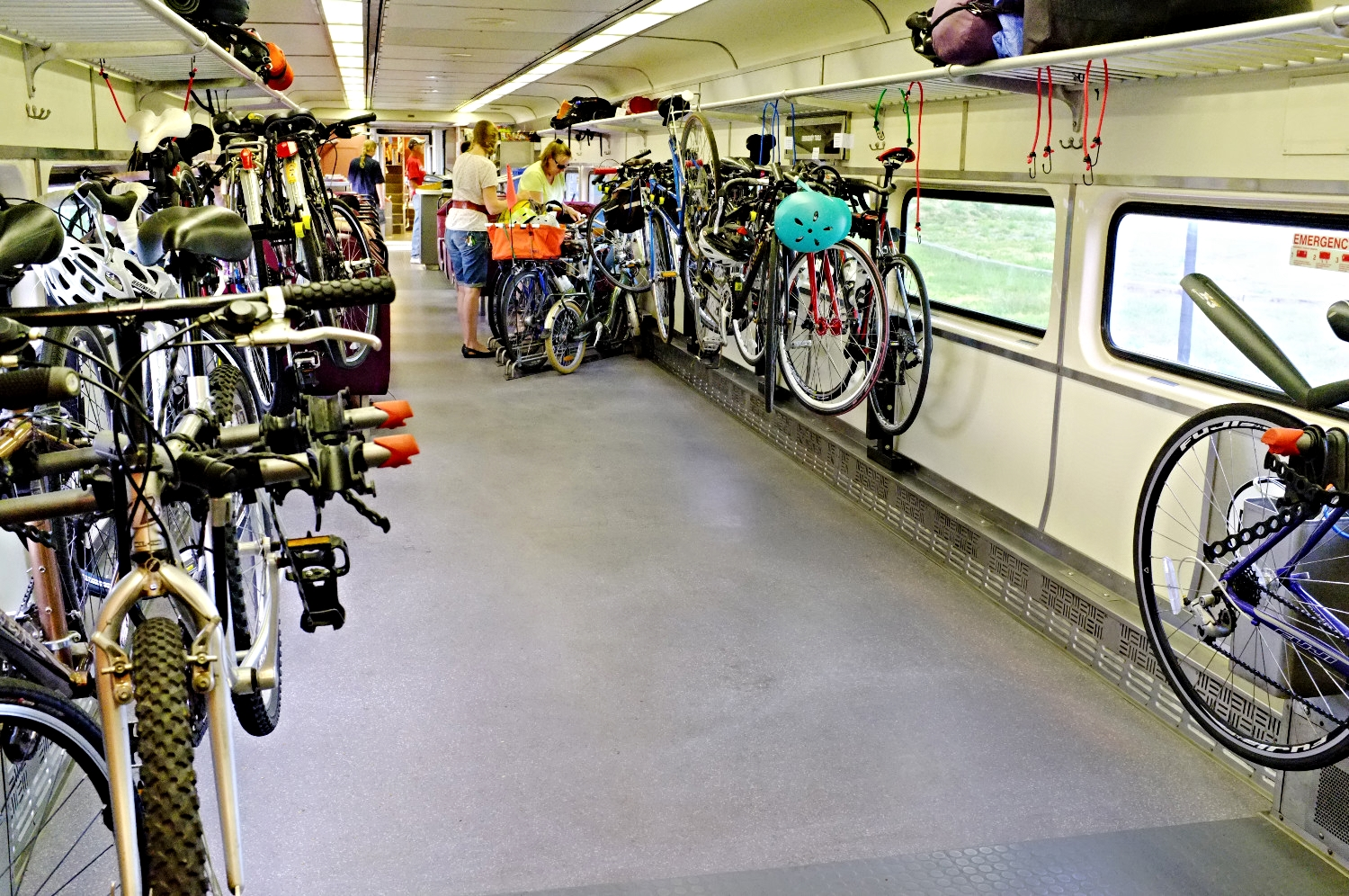 CapeFlyer's bike car is convenient for 3 reasons: 1) roll-on from the platform (no lifting), 2) floor and hanging bike storage and 3) IT'S NEXT TO THE BAR CAR!