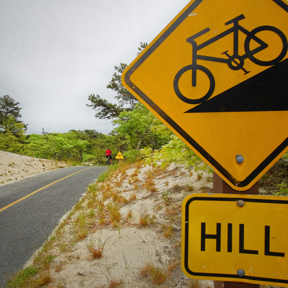 These signs are no joke! Steep downhills + sand + other riders can equal disaster so take care and you'll have an excellent time!