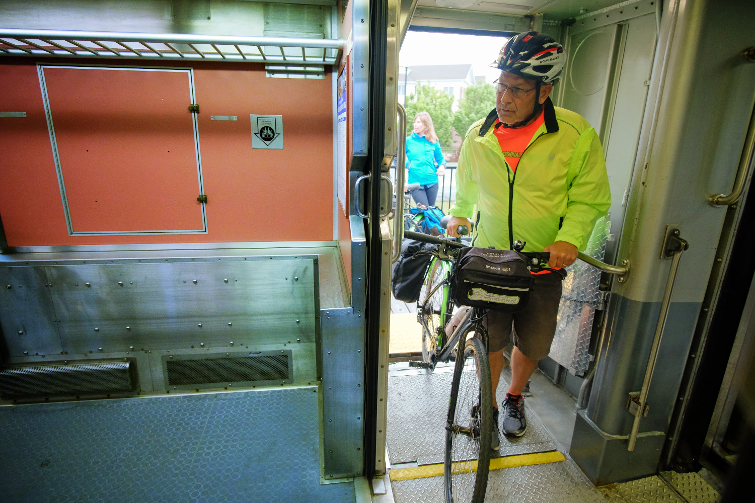 Grade level roll-on service with a wide door into the bike car.
