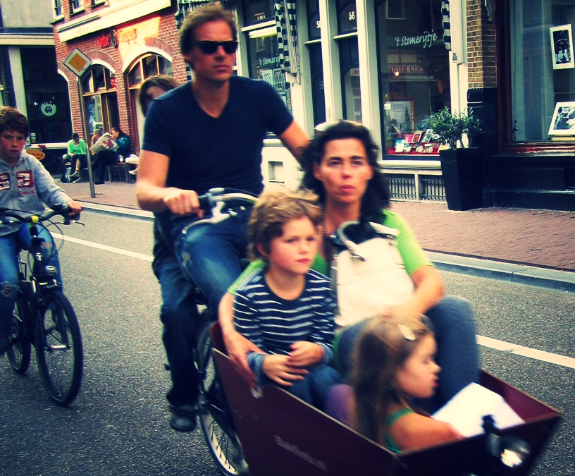 5 on a bike with 1 trailing. The Netherlands are family biking professionals.