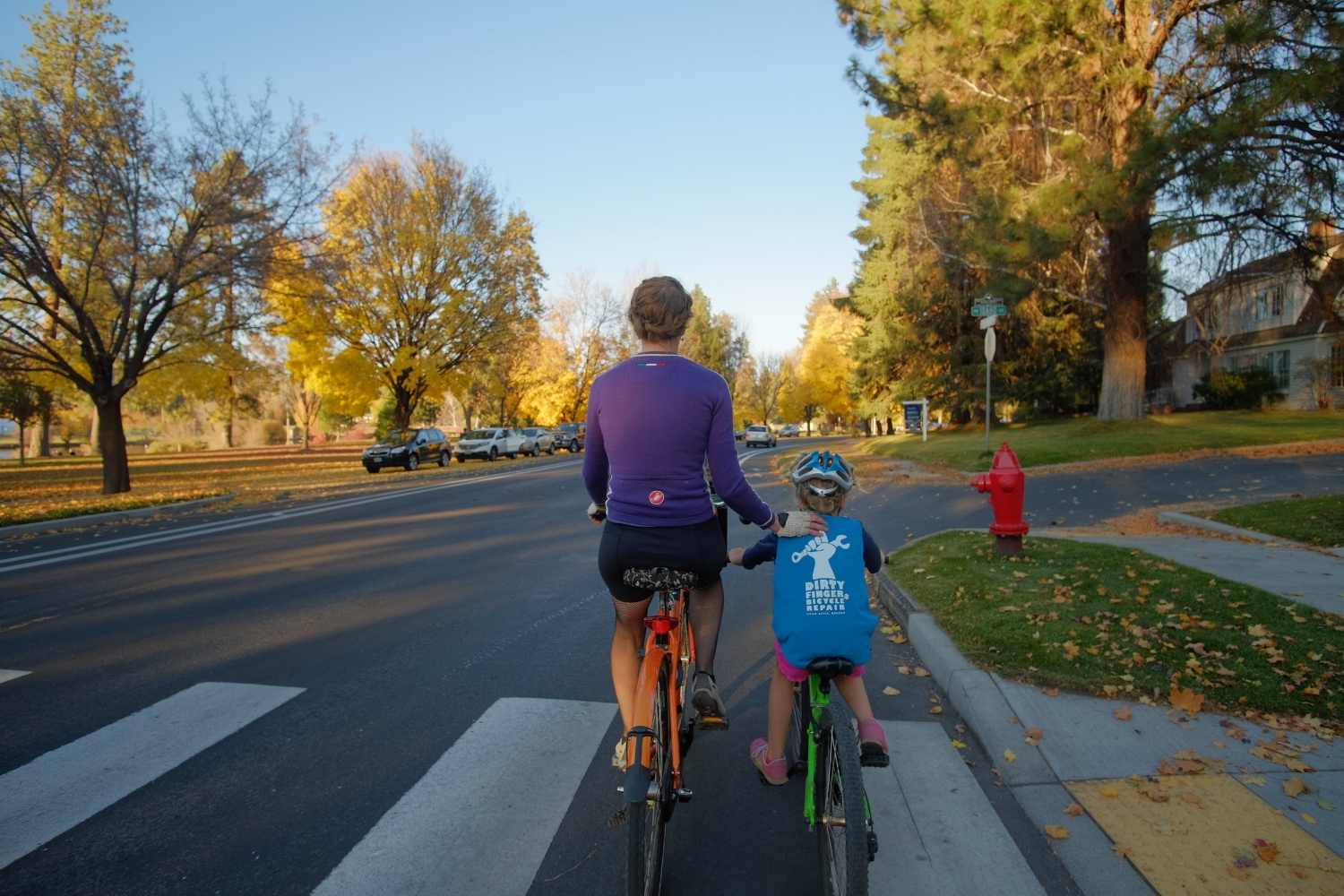 Founder Megan Ramey, riding with her daughter, Annika, on Riverside Boulevard, a street that might be ripe for some bollards to make it safer for families.