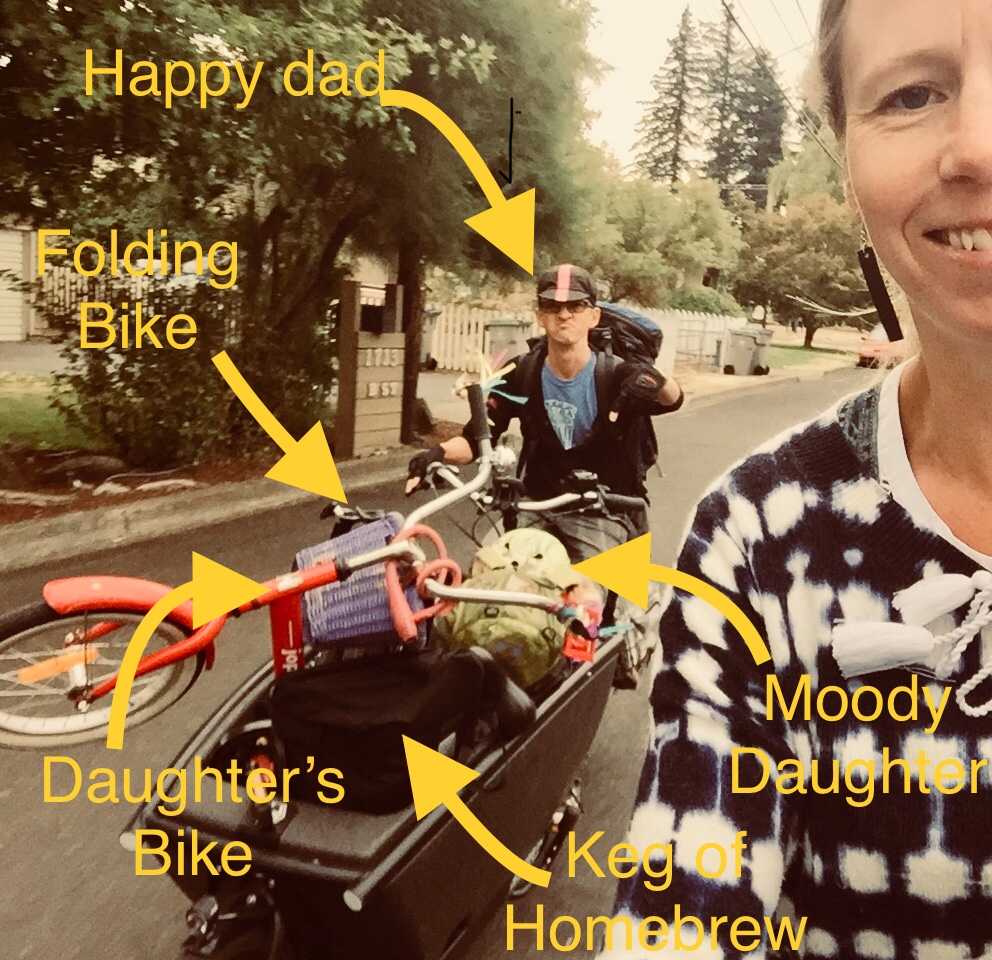 Transporting child and her bike, luggage and a keg of beer to the bus for a weekend in Portland #ebikesarecheating