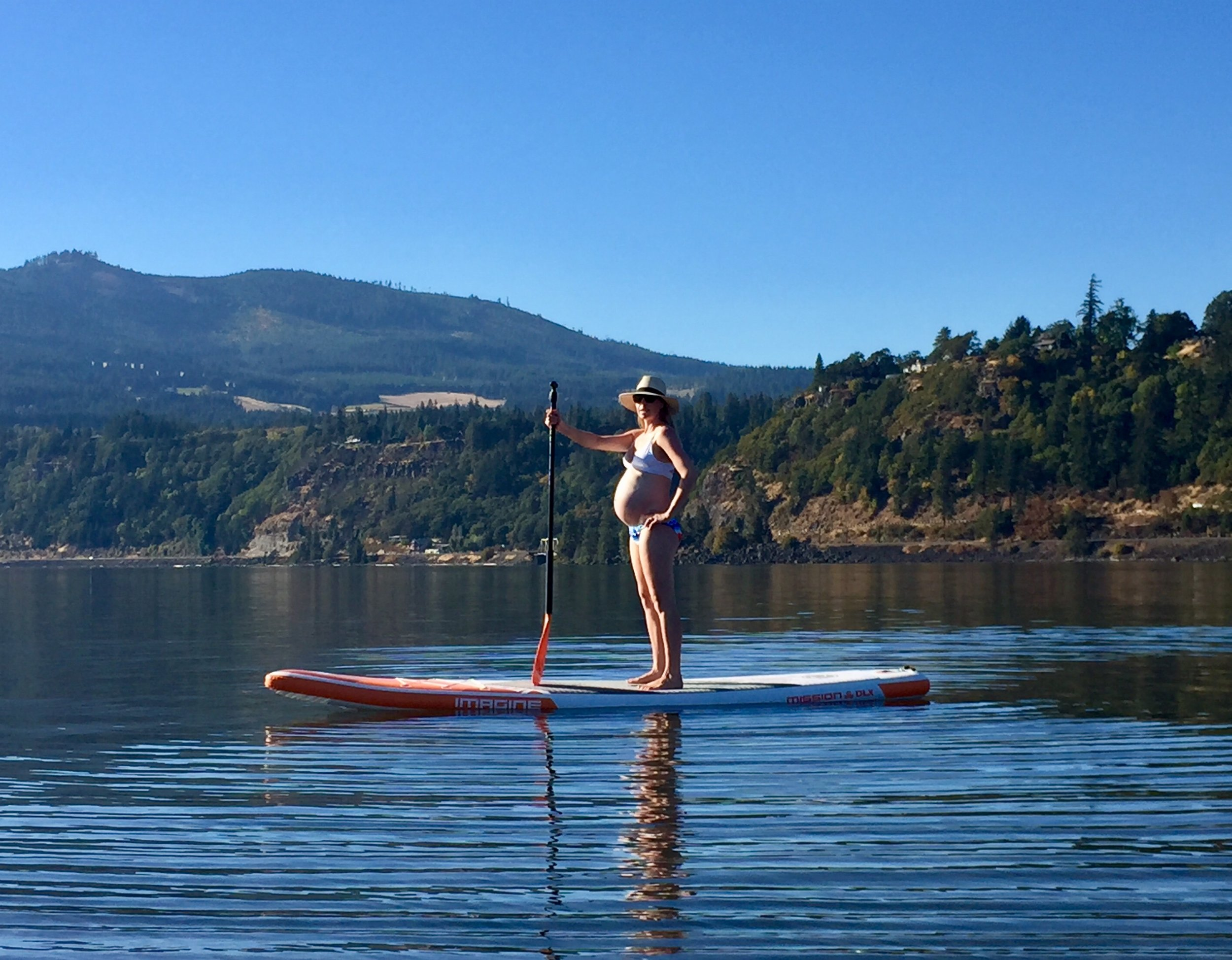 8 months, paddle boarding
