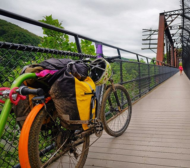 A story of fender ❤️ and a Mayor's hose 💦 kindness. We had enough foresight to know electric ⚡️ assist was necessary for our family to enjoy the 340 mile ride from Pittsburgh to DC on the Great Allegheny Passage trail and C&O. BUT, in our effort to procure an #ebike from @pedego that would accommodate the @burleydesign Piccolo trailerbike, we didn't anticipate mud. Kyle is a ninja with bike hacks and outfitted this rando cruiser fender and we were all significantly dryer and cleaner than we would have been. Still, walking all crusty across this bridge to Harper Ferry at the end of a very muddy day, we were exhausted and just wanted water, for our bodies and bikes. Our lodging didn't have a hose so I started walking down the street and noticed a sprinkler and knocked on the door. The lady who answered the door was weary, but when she saw my then 6 year old daughter, she warmed up and shoved the hose at us. She turned out to be the Mayor's wife and our bikes were sooooo grateful to sleep clean that night. #bikewander #familybiketour #ebikesarecheating . . . Tag @bikabout and we'll share your ebike story. Instagram link is our recent Bikabout.com/blog  showcasing all the amazing adventures and everyday life stuff that these ⚡️😀 machines have a hand in. . . #ihavethisthingwithbikes #bikeride  #wanderbybike #bikelife #cycling #biking #cyclinglife #cyclingtour #travelphotography #familybikeride #pedego #ebikes #electricbike #electricbikes #familyhacks #lifehacks #kindness @wvtourism @harpersferrynps