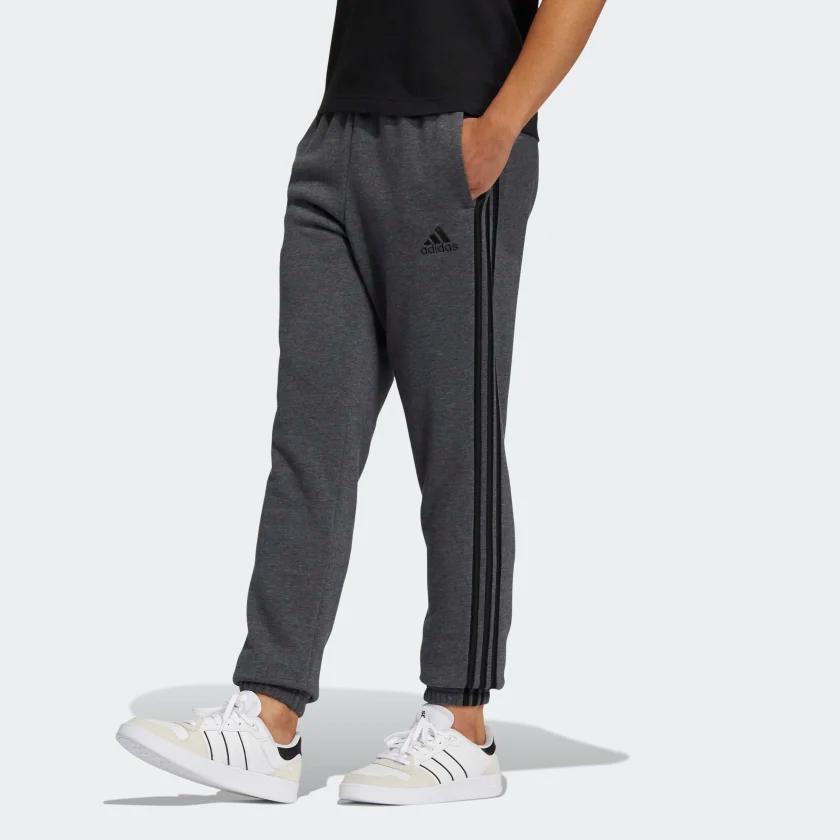 Essentials_Fleece_Tapered_Elastic_Cuff_3-Stripes_Pants_Grey_GK8891_21_model.png