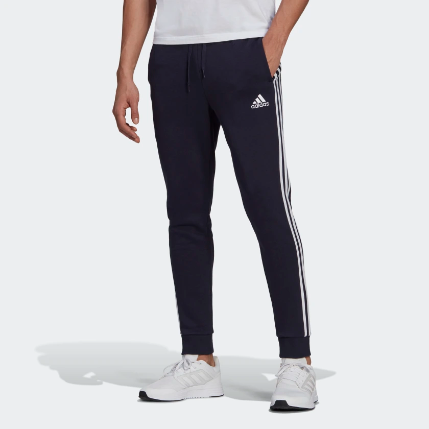 Essentials_Fleece_Tapered_Cuff_3-Stripes_Pants_Blue_GK8823_21_model.png