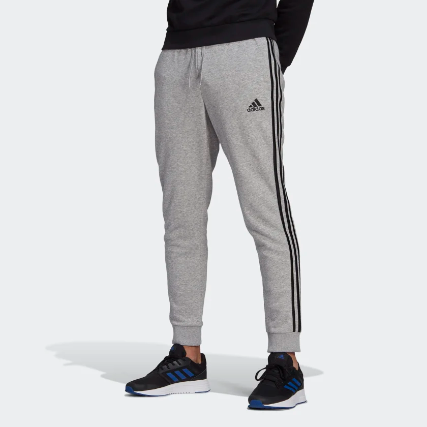 Essentials_Fleece_Tapered_Cuff_3-Stripes_Pants_Grey_GK8824_21_model.png