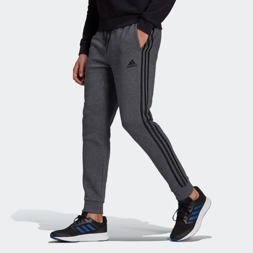 Essentials_Fleece_Tapered_Cuff_3-Stripes_Pants_Grey_GK8826_21_model.png