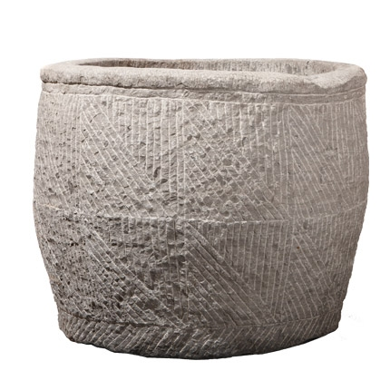 The thing I love about Pennoyer and Newman is their variety: modern, traditional, and then they have pieces like this that look like ancient found relics. This is their concrete cast Japanese Rainbarrel that is made from a hand carved mold.  Price: $1,800 .
