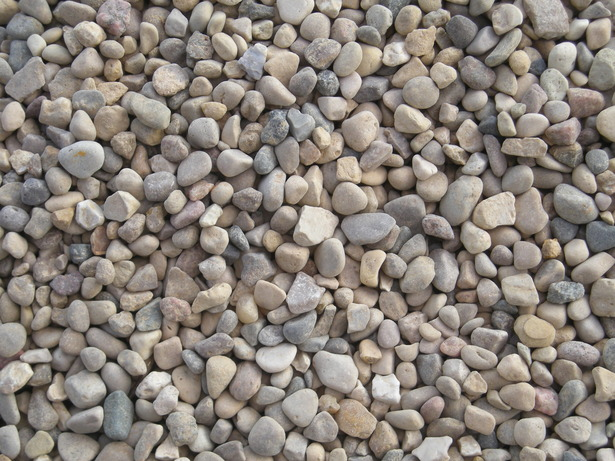 Pea Gravel  can be a great source of warmth and texture, and it is eco friendly because it drains, and it is inexpensive too.