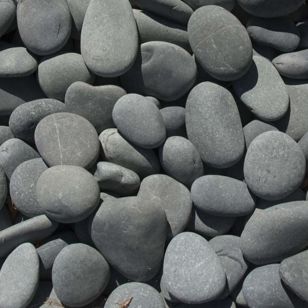 River stones   are a beautiful hard but soft texture, great for hiding things on the ground if you have an area that is uneven or unattractive that you want to hide. also great for drainage. Their appeal is both aesthetic and practical.