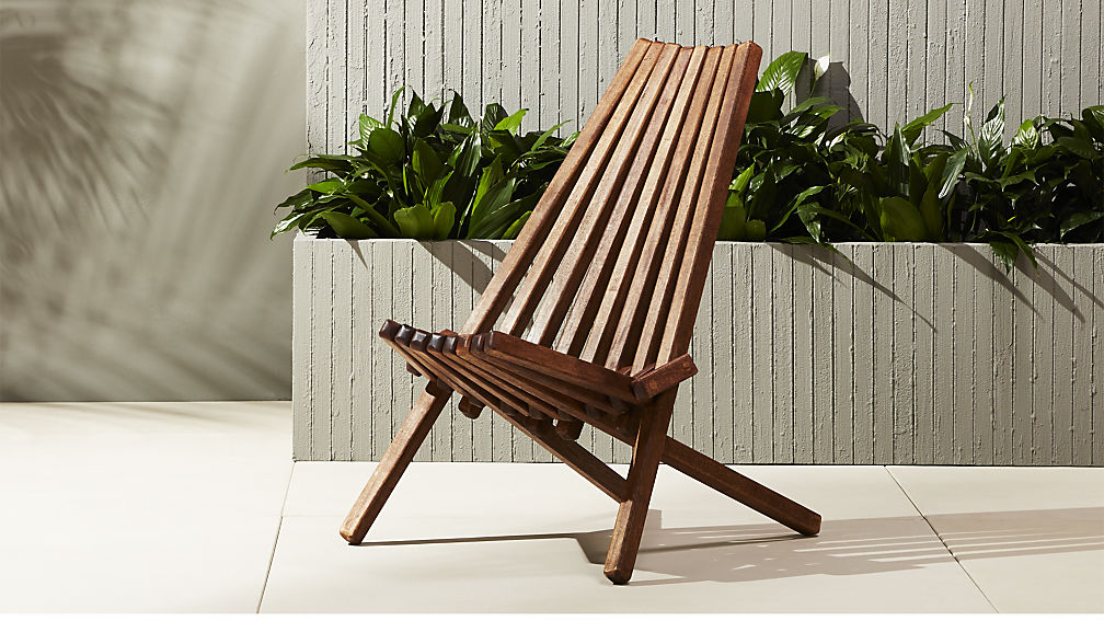 The Maya Wood Outdoor Chair by CB2 is a timeless design, made in Mexico from a tree called the Tabebuia rosea, which is a sustainable wood. It also is a folding chair, which makes for easy storage for that garden party that always gets one extra person.   View Product Website