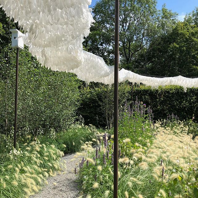 Mark Thomann designed an ethereal and elegant garden installation for the International Garden festival in Domaine Chaumont-sur-Loire.  The theme this year was 'Gardens of Paradise' and this garden, entitled Float, Flutter, Flow examines the relationship between nature and the man-made. It features a floating cloud-like canopy made of feathers over a misty landscape of grasses, wild blueberries and flowering perennials, and dotted with small white birdhouses that invite wildlife to this garden sanctuary.  Garden by Mark Thomann + Naeem Shahestani of wHY. Photo by Mark Thomann