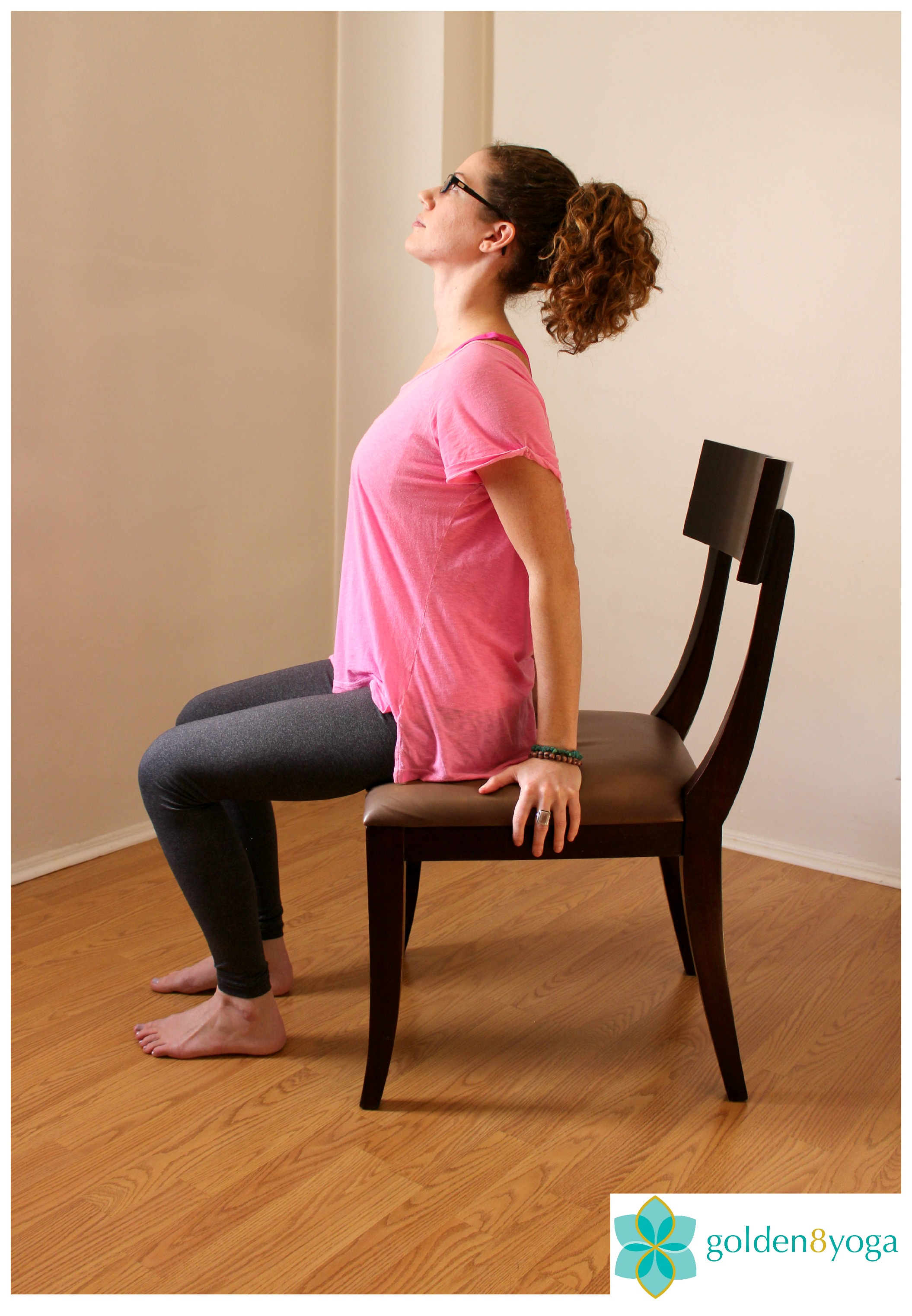 SEATED BACKWARDS BEND  Try this pose if you have stiffness in your back and tension in your shoulders. Benefits include increased mobility in the back and shoulders, and relieves shoulder and back tension.  1. Sit comfortably in a chair with your feet hip width distance and parallel to each other. Sit up tall with your back, neck and head in a straight line and shoulders relaxed.  2. Place both hands on the chair underneath or slightly behind your shoulders with elbows slightly bent. Inhale here.  3. Exhale and press your hands into the chair and gently bend your torso backwards. Keep your head in line with your back with your gaze looking up towards the ceiling.   4. Hold this pose for a few seconds breathing normally, then on your next inhale slowly return to your starting seated position and repeat on the second side.   **Tip: Be careful not to drop your head back too far as it can constrict your breathing and cause strain on your neck. Only tilt your head back as far as it feels comfortable on your neck**