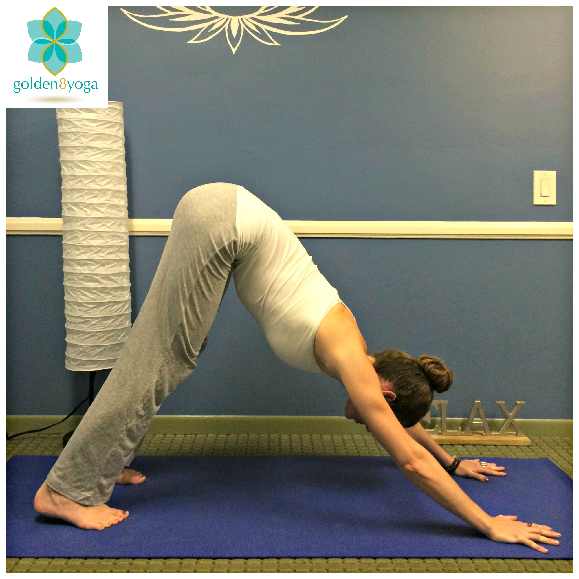 Downward Facing Dog  Try this pose for an overall stretch of the body after a long day of work or to release tightness in the body to help promote relaxation. Downward Facing Dog opens the chest, stretches the back, lengthens the spine, and stretches the back of your legs.  1. Start on your hands and knees in a table top position. Hands will be shoulder width distance and tuck your toes under. (Not pictured)  2. Begin to press your palms and all fingers into the floor and lift your hips up and back turning your body into an upside down 'V'.  3. Be sure to not lock your elbows or knees. Make sure your middle finger lines up with the middle of your wrist, and your feet are about hip-width distance apart.  4. Lift up through the tailbone so that your spine lengthens and feel your chest moving closer to your thighs. If it would feel good to you, begin to 'walk your dog' by bending each knee one at a time to help release tension in the body.  5. Hold this pose for 5-10 breaths, then release back into table top. Repeat 1-2 times more.