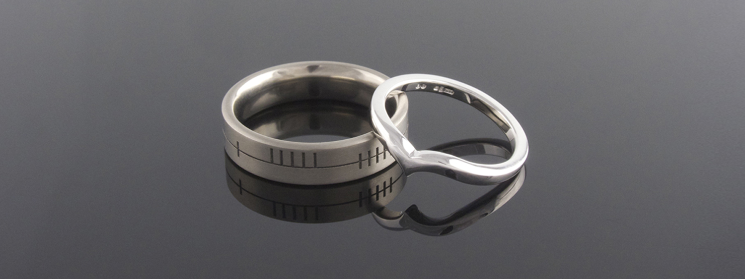 Titanium and 18ct white gold shaped wedding bands