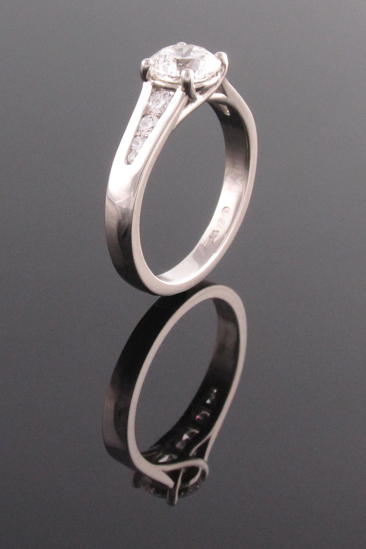 Platinum 4 claw diamond solitaire engagement ring