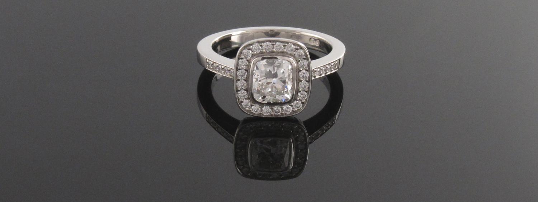 Platinum cushion cut diamond cluster engagement ring with pave shoulders - Eva Dorney Goldsmith