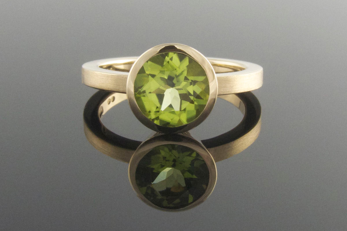 Bezel set peridot engagement ring