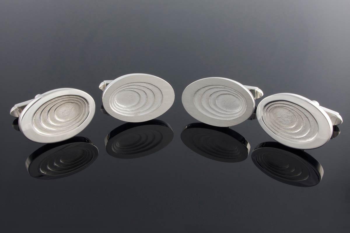 Graduated oval sterling silver cufflinks