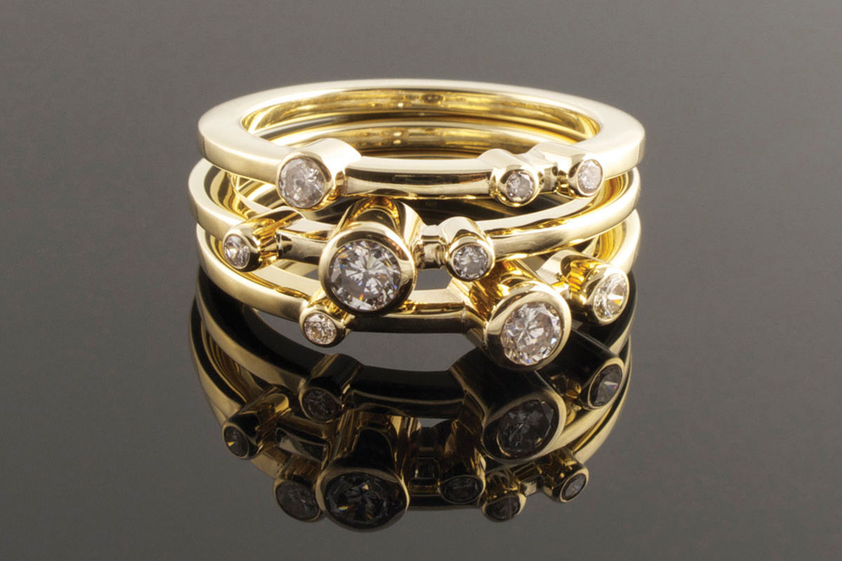 Three yellow gold and diamond rings
