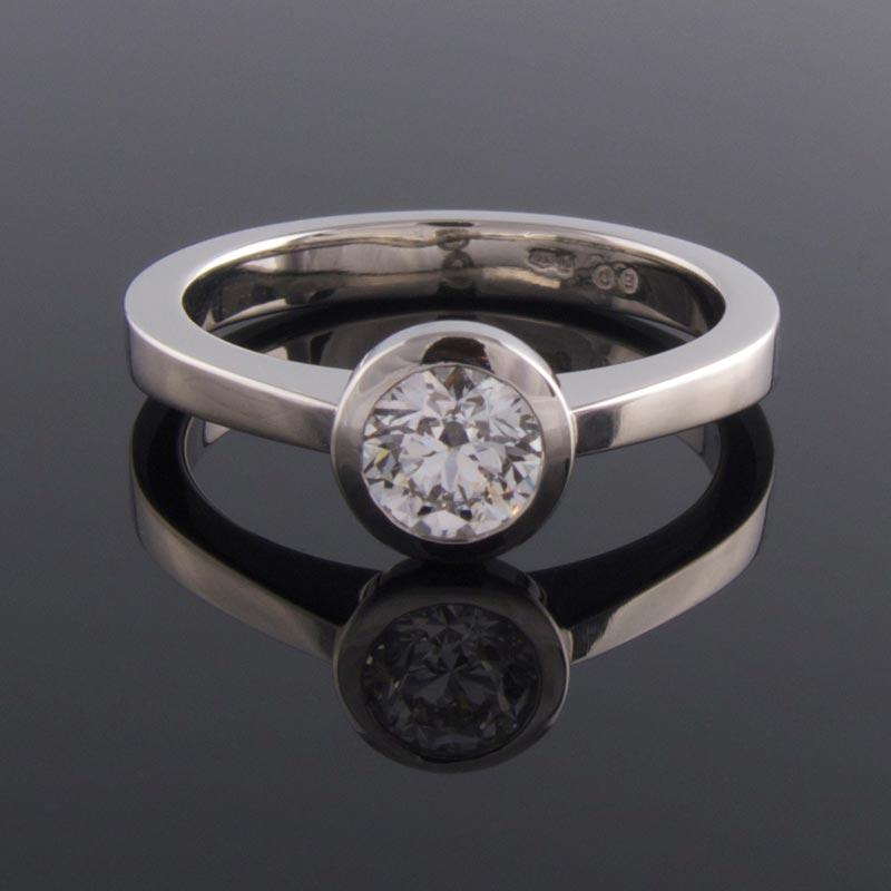Bezel set platinum solitaire engagement ring