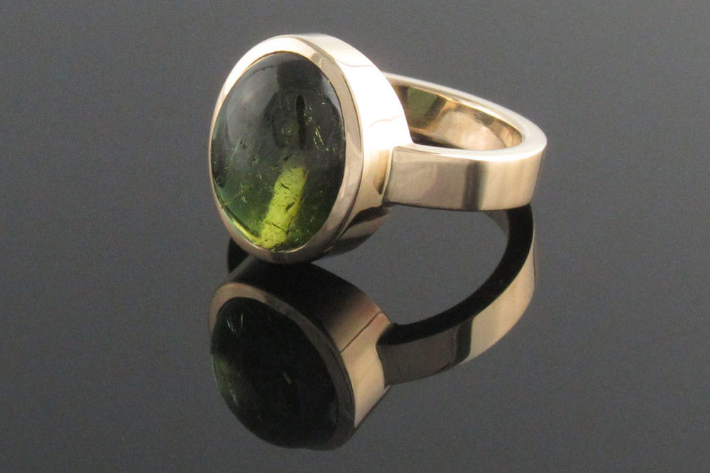 Recycled yellow gold and green tourmaline ring
