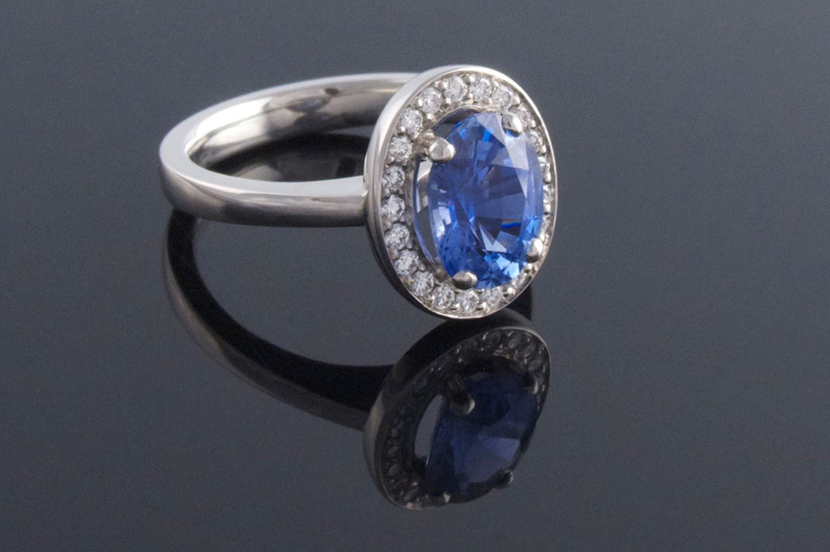 Bespoke 4 claw sapphire cluster engagement ring