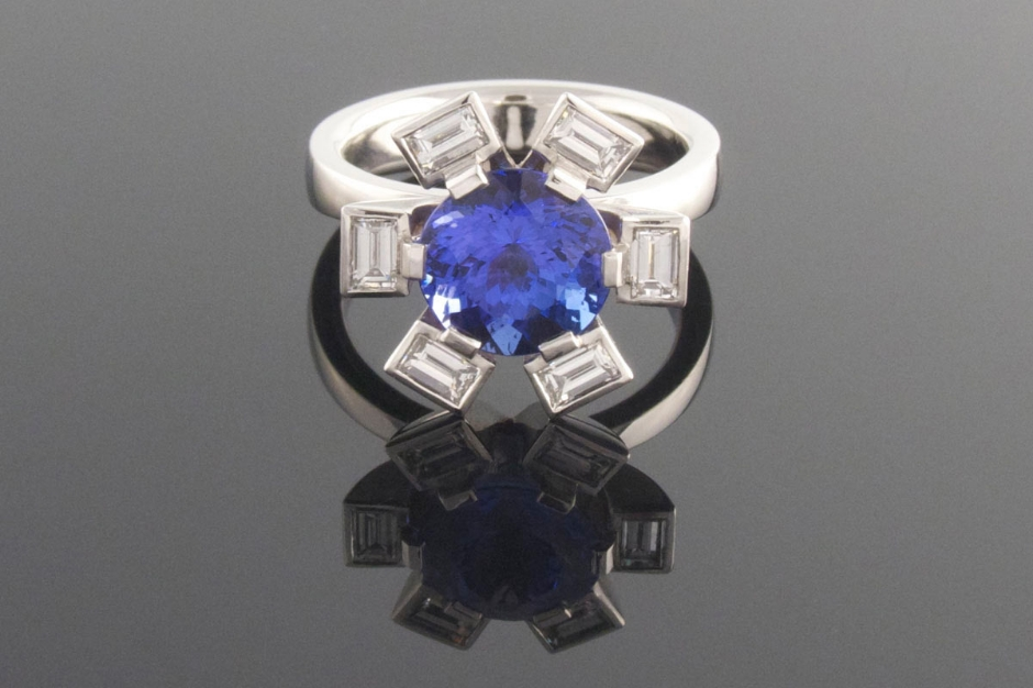 Platinum 6 claw tanzanite and diamond dress ring