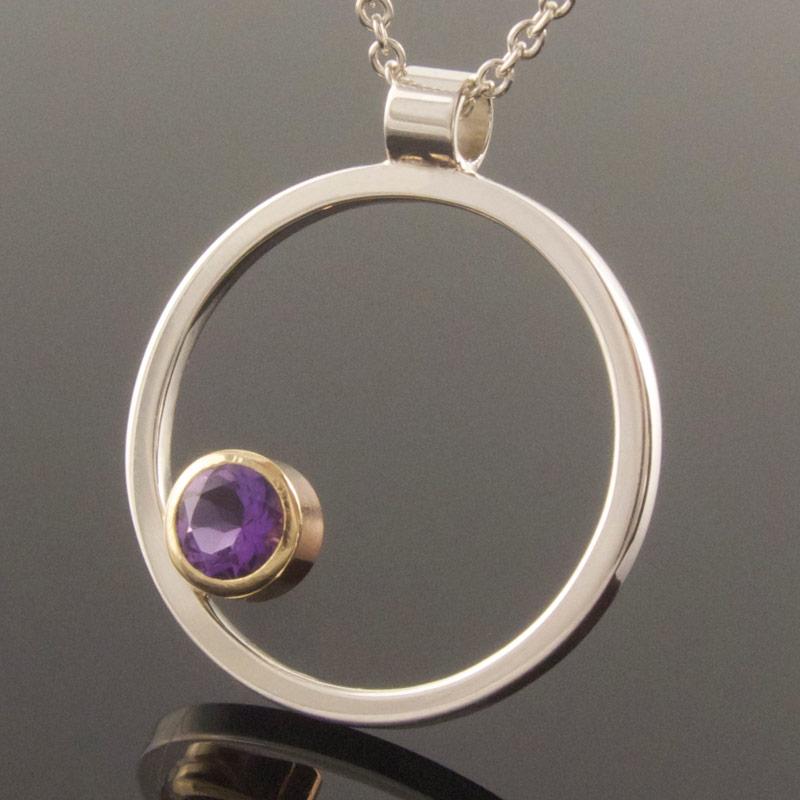 Amethyst-circle-pendant-silver-gold.jpg