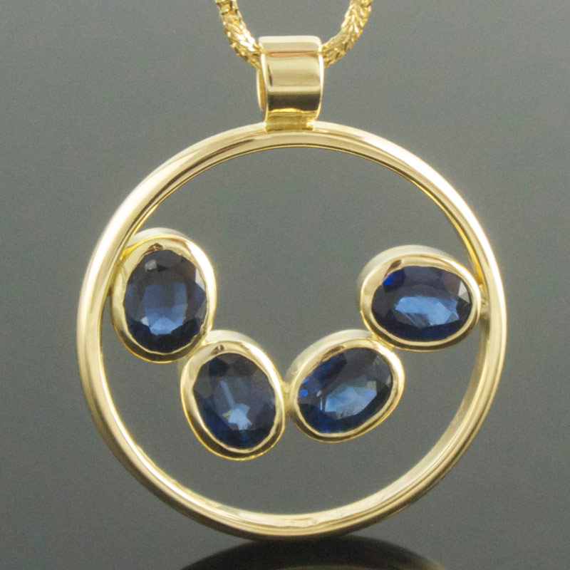 Four-stone-oval-blue-sapphire-circle--pendant.jpg