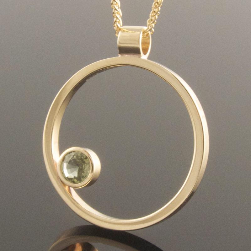 Green-sapphire-circle-pendant-2.jpg