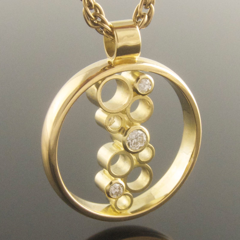 Three-stone-diamond-circle-pendant-with-empties.jpg
