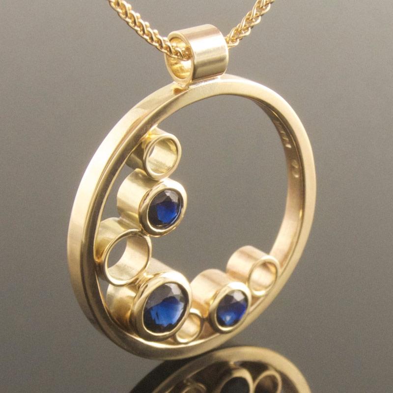 Three-stone-sapphire-circle-pendant.jpg