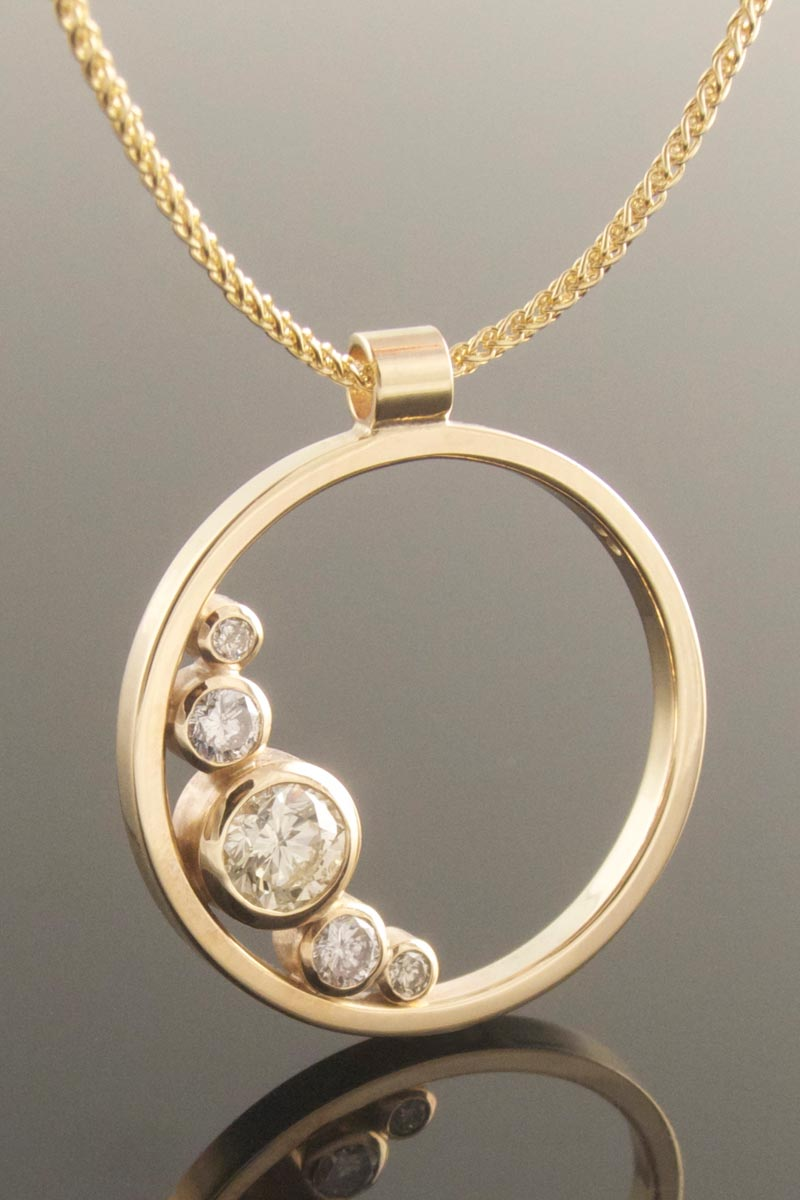 Recycled yellow gold and diamond circle pendant