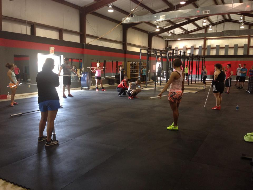 Coach Sheppard teaching a progression on Coach Smith in Petal, Mississippi. Photo credit: Katie Graverson