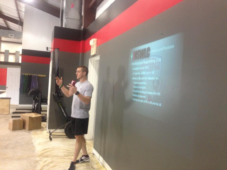 Coach Smith discussing the origin of the sport and the club at a gym in Petal, Mississippi. Photo credit: Amber Sheppard